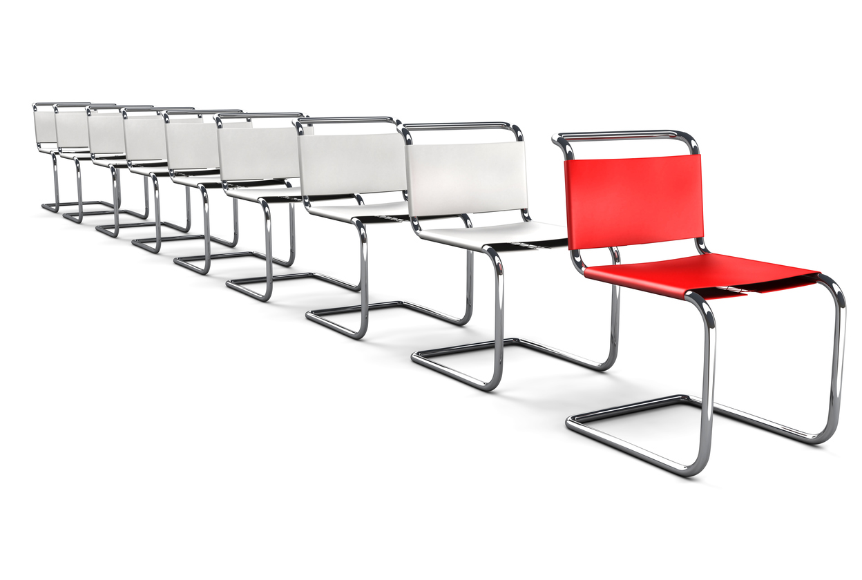 Modern Office Chairs in a line with the Red one Standing Out in the Front.The Office Chair Concept series