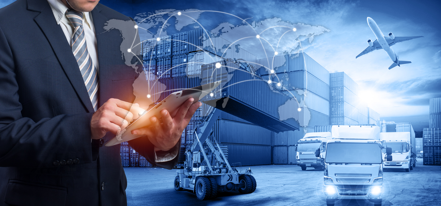 Hand holding tablet is pressing button on touch screen interface in front Logistics Industrial Container Cargo freight ship