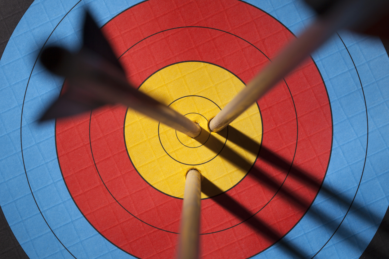 Three arrows on an archery target.