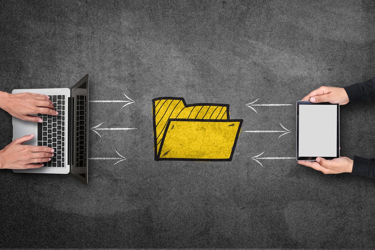 Online file transfer using laptop and digital tablet on blackboard