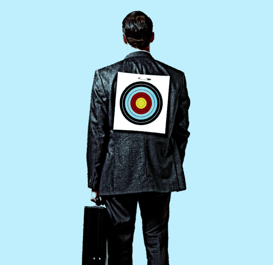 Businessman Standing With A Target On His Back