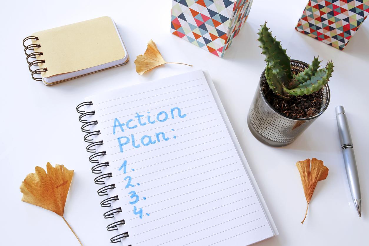 action plan written in notebook