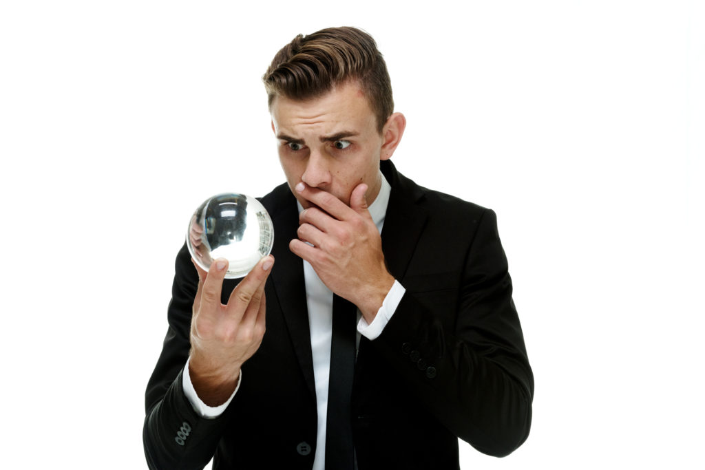 Terrified businessman with crystal ball