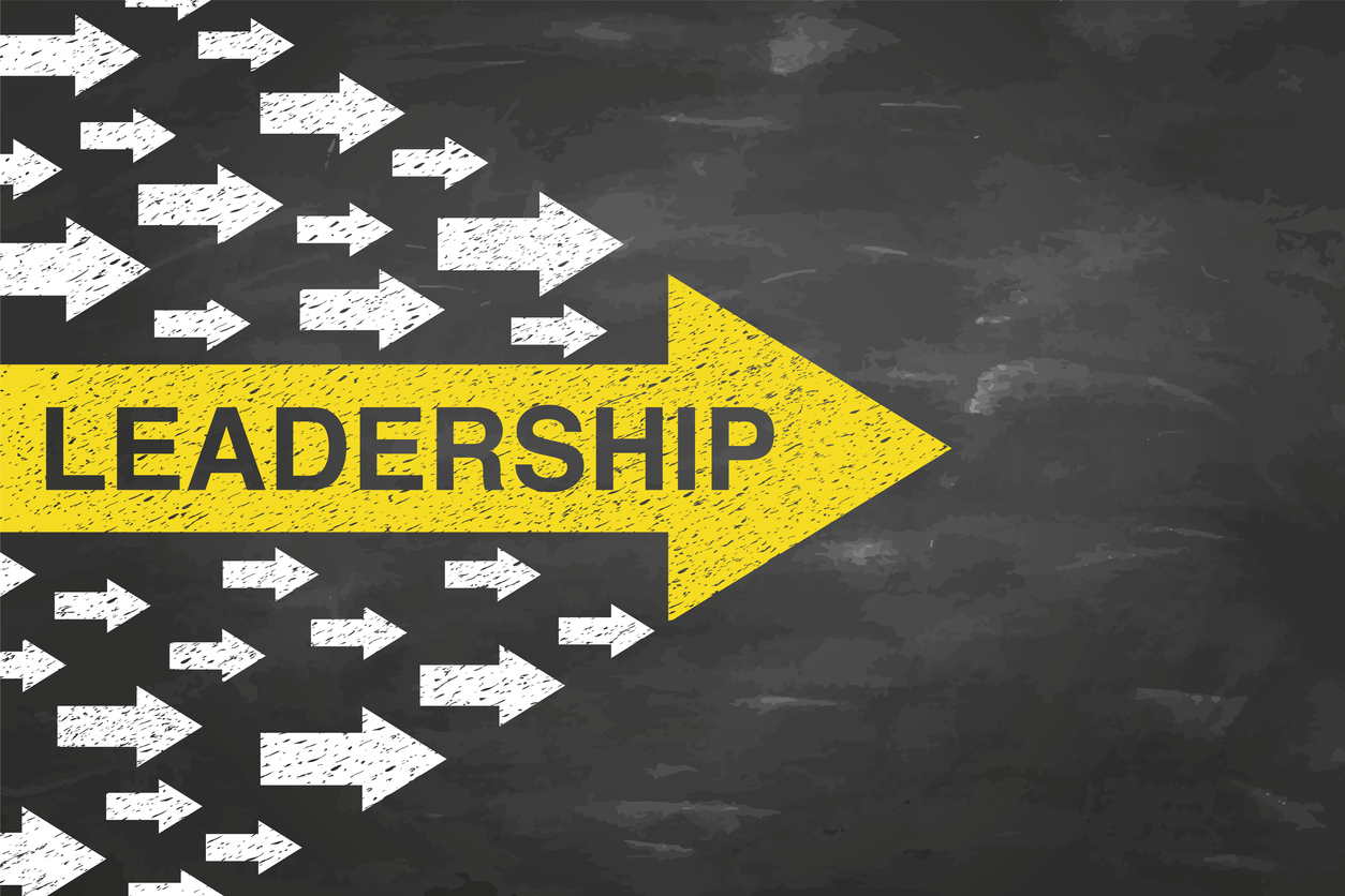 Leadership Concepts with Arrows on Blackboad Background