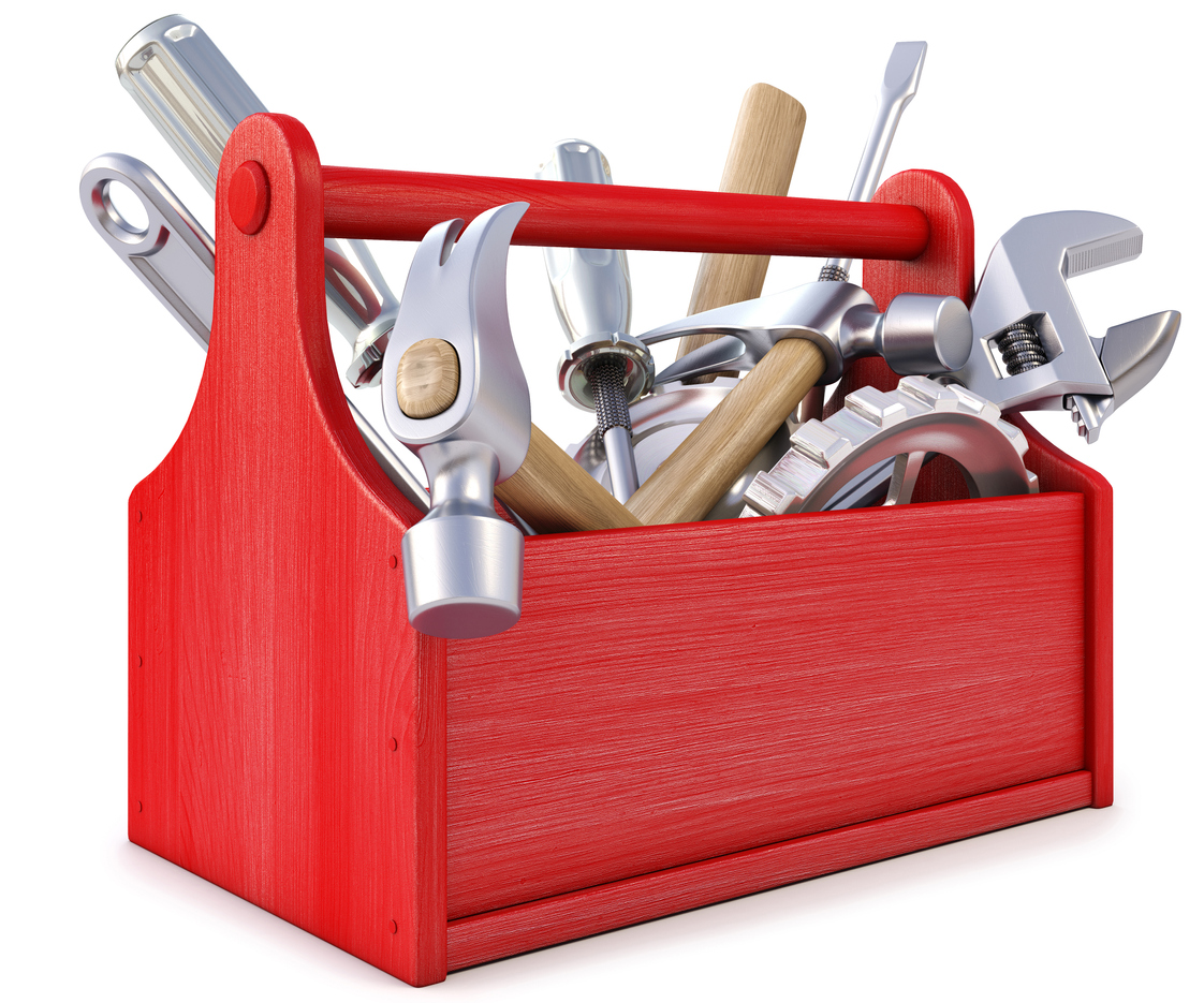 Red wooden toolbox with tools on white background