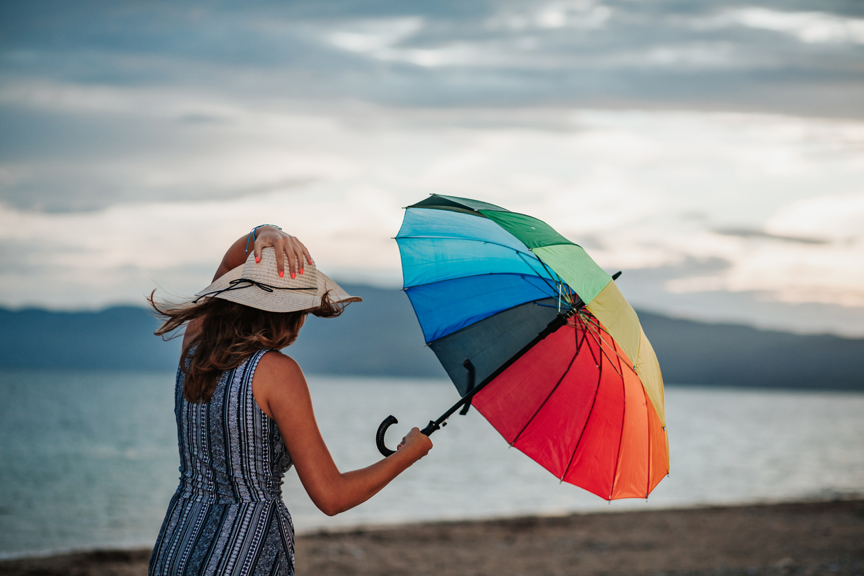 Woman with rainbow umbrella